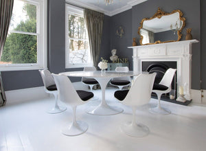 Edwardian dining room with marble Tulip Table and 6 Tulip chairs with black cushions