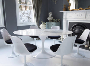 Closer view of Tulip Dining set with black cushions in classic dining room setting