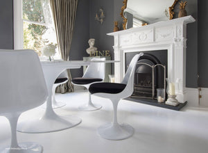 Tulip Side Chair with black cushion in classic dining room setting