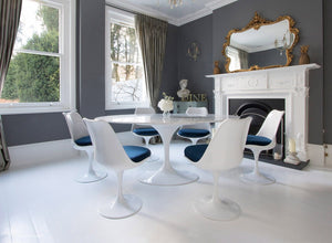 Edwardian dining room with marble Tulip Table and 6 Tulip chairs with blue cushions