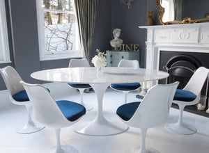 Closer view of Tulip Dining set with blue cushions in classic dining room setting