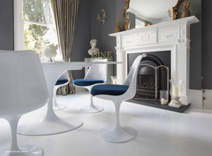 Tulip Side Chair with blue cushion in classic dining room setting