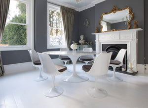 Edwardian dining room with marble Tulip Table and 6 Tulip chairs with grey cushions