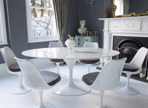 Closer view of Tulip Dining set with grey cushions in classic dining room setting