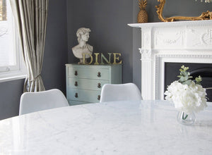 Close up view of the Tulip dining set with marble and side chairs