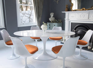 Closer view of Tulip Dining set with orange cushions in classic dining room setting