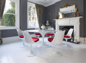 Edwardian dining room with marble Tulip Table and 6 Tulip chairs with red cushions