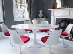 Closer view of Tulip Dining set with red cushions in classic dining room setting