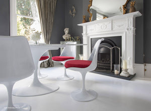 Tulip Side Chair with red cushion in classic dining room setting