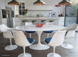 Main view of 170cm White table with four side and two tulip arm chairs with blue cushion