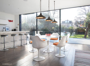 Room with the 170cm White table and chair set with orange cushion