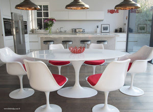 Main view of 170cm White table with four side and two tulip arm chairs with red cushion