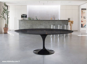 The full size Saarinen Tulip Oval table in black Portoro Marble is a sight to behold with deep texture and natural veins
