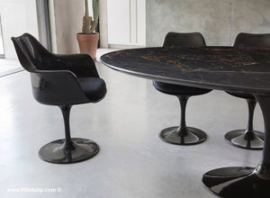 The largest Saarinen Black Tulip Table with Black cushions dominates the room