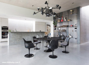 The largest Saarinen Black Tulip Table with Grey cushions dominates the room
