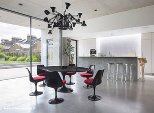 Welcome to the dark side, a mesmerising Tulip dining set finished with red cushions