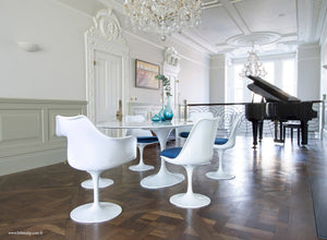 Classic dining room with piano, wooden floor, marble tulip table and 6 chairs with blue cushions