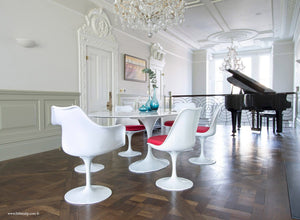 Classic dining room with piano, wooden floor, marble tulip table and 6 chairs with red cushions