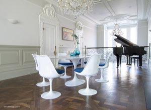 Beautiful dining room with grand piano & Tulip dining set with blue cushions