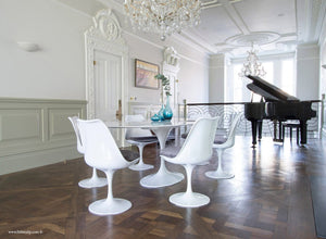 Beautiful dining room with grand piano & Tulip dining set with grey cushions