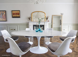 Oval marble Tulip Table with 6 Tulip Side chairs in grey on wooden floor