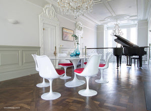 Beautiful dining room with grand piano & Tulip dining set with red cushions