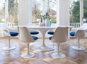 Main view of large oval white tulip table and blue cushioned side chairs