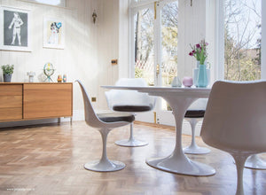Wooden orangery floor, tulip chair with a grey seat cushion