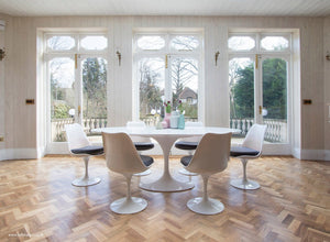 huge windows and wooden floor room with tulip oval table and chairs