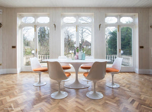 natural light in a large dining room with tulip table and chair set
