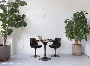 The Portoro Marble Saarinen table cafe set with black cushions