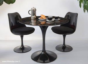 The amazing natural veins in this marble tulip table set with 2 chairs in black