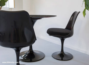The wonderful back Tulip Table and Tulip Chair sets come here with black cushions