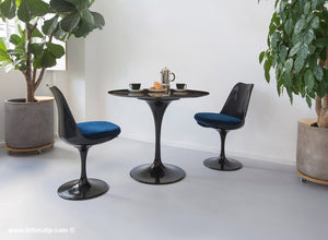 The 90cm TUlip dining set is so versatile and the two chairs come with blue cushions