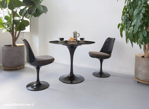 The 90cm TUlip dining set is so versatile and the two chairs come with grey cushions