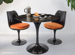 The amazing natural veins in this marble tulip table set with 2 chairs in orange