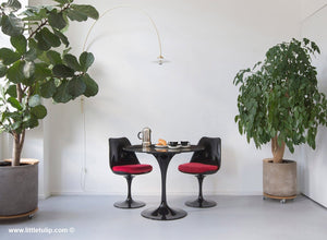 The Portoro Marble Saarinen table cafe set with red cushions