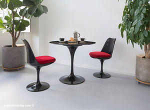 The 90cm TUlip dining set is so versatile and the two chairs come with red cushions