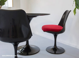The wonderful back Tulip Table and Tulip Chair sets come here with red cushions