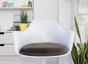 Close up view of the Tulip Arm Chair with grey cushion
