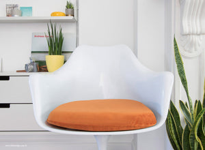 Close up view of the Tulip Arm Chair with orange cushion