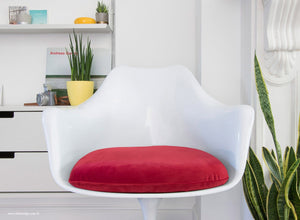 Close up view of the Tulip Arm Chair with red cushion