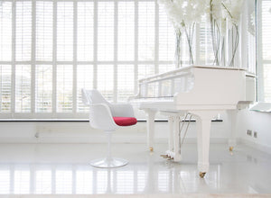 Tulip Arm Chair with red cushion and white Grand Piano