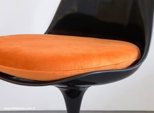 Our Saarinen Tulip Chairs shown with the luxurious soft to the touch orange cushions