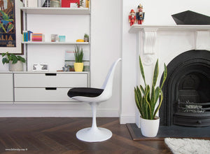 Side view of Tulip Side Chair with black cushion