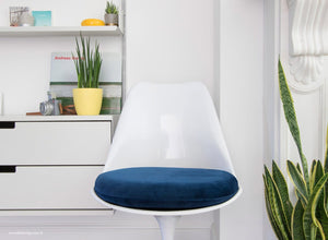 A soft and luxurious blue tulip side chair cushion