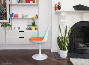 Side view of Tulip Side Chair with orange cushion
