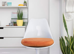 Close up view of Tulip Side Chair with orange cushion