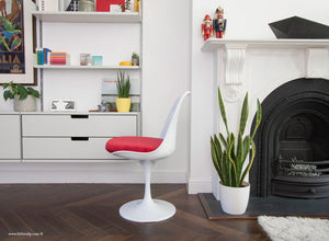 Side view of Tulip Side Chair with red cushion