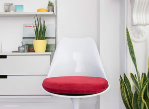Close up view of Tulip Side Chair with red cushion